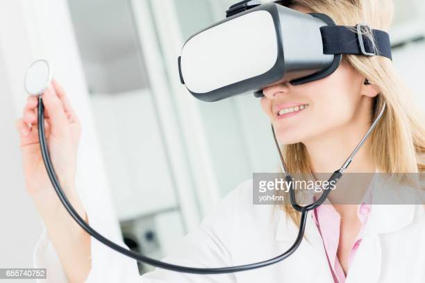 Female cardiologist using virtual reality headset