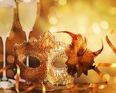 Female carnival mask with golden background