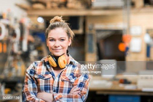 Female carpenter at work in her work shop.