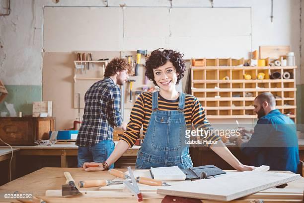 Female carpenter in a construction workshop