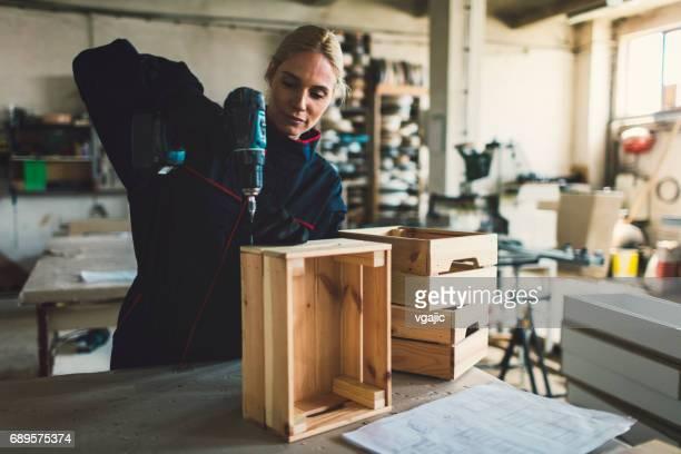 Female Carpenter Working In Her Workshop