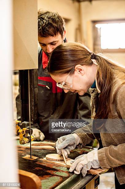 Female Carpenter Working in Workshop