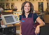 Female cashier smiling, portrait