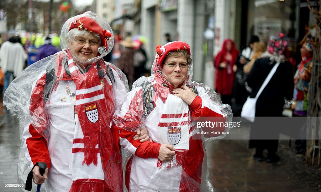 Female celebrate during a carnival parade called 'Schull- un Veedelszoech' as part of the carnival season on February 7, 2016 in Cologne, Germany. Carnival partying and parades, a centuries-old tradition in western and southwestern Germany, traditionally occurs in February and runs until Ash Wednesday, the start of Lent, and culminates in Rose Monday parades and festivities. Police are on added alert this year, particularly in Cologne, due to the New Year`s Eve sex attacks on women that have been attributed to gangs of North African men, predominantly from Algeria and Morocco.