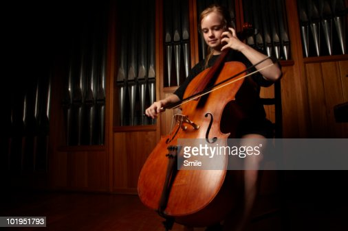 Female cellist playing the cello