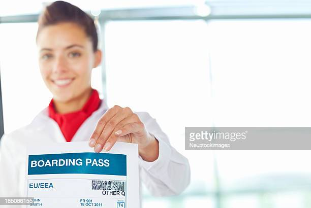 Female Check-In Attendant Holding Boarding Pass