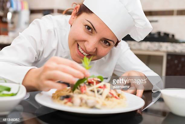 Female Chef Completing Pasta