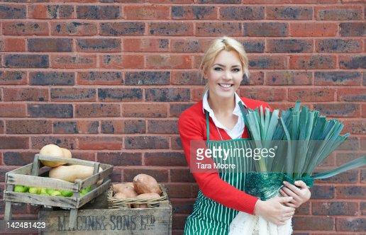 female chef holding fresh vegetables : Stock Photo