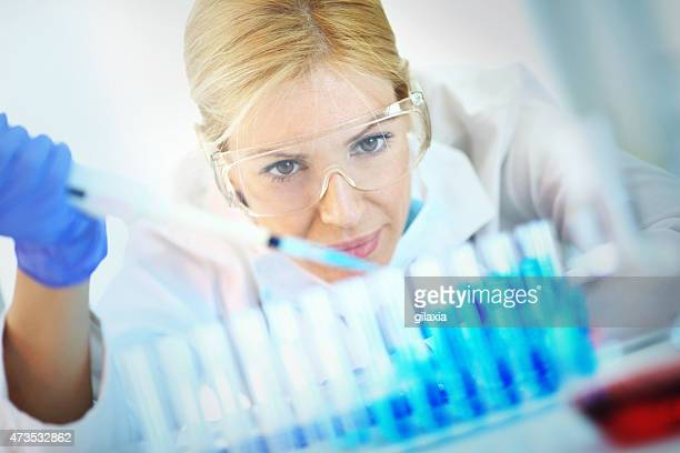 Female chemist at work in laboratory.