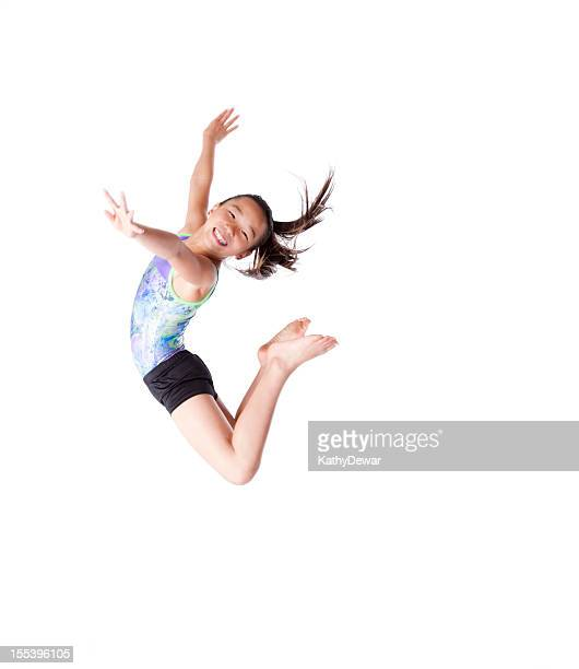 Female child gymnast jumping in the air