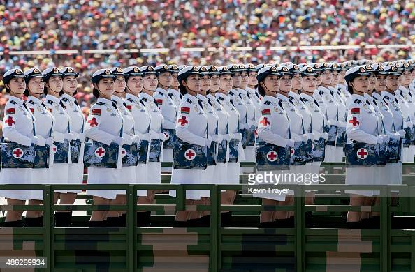 Female Chinese soldiers of the medical corps ride in trucks as they pass in front of Tiananmen Square and the Forbidden City during a military parade...
