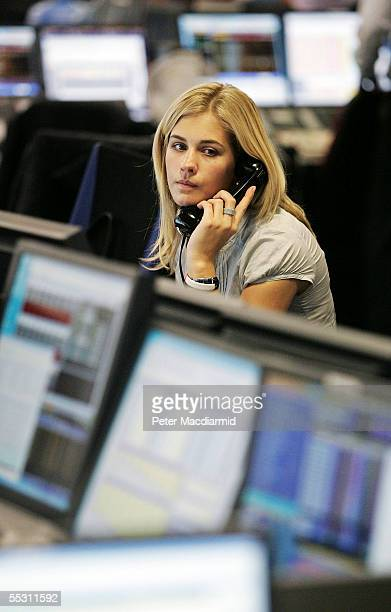 A female city worker buys and sells stocks on the BGC trading floor on September 7 2005 in London
