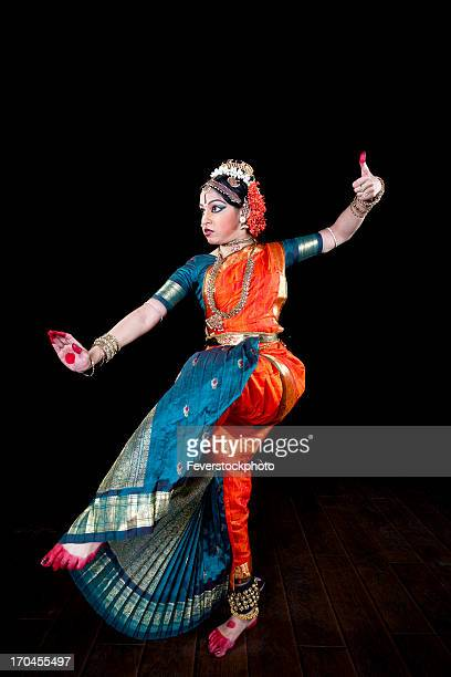 Female Classical Indian Dancer Performing On Stage