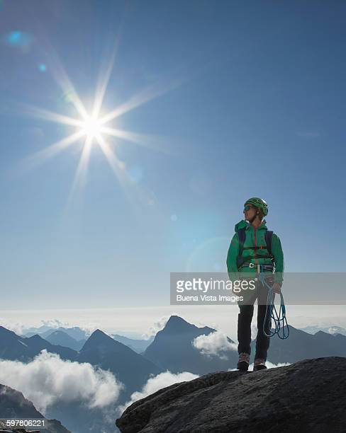 A female climber on a mountaintop