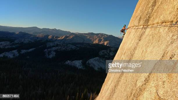 Female climber on the Lamb Dome traverse in Tuolumne, Yosemite National Park