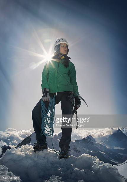 Female climber on the top of a mountain
