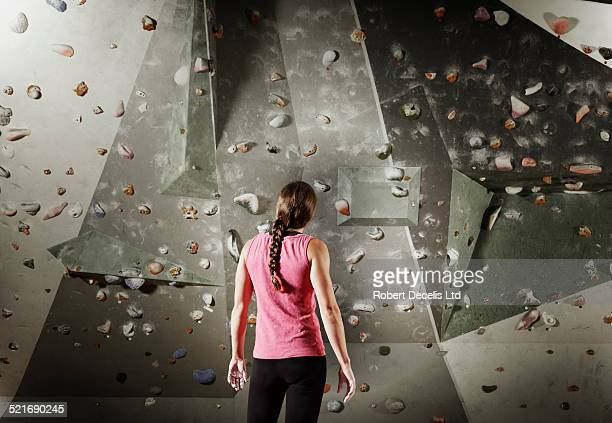 Female climber preparing to climb climbing wall