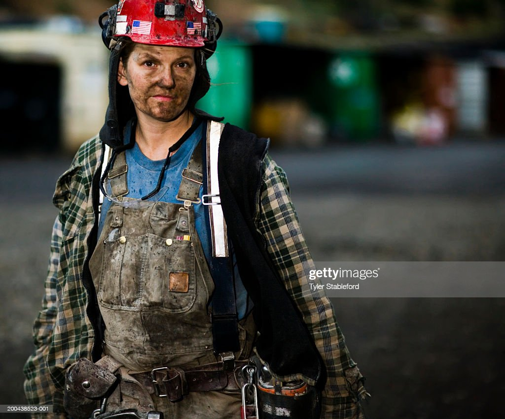 Female coal miner outdoors, portrait, close-up