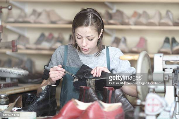 Female cobbler in workshop