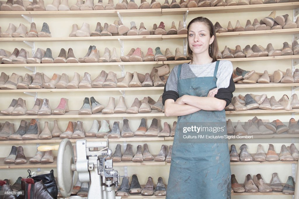 Female cobbler in workshop : Stock Photo
