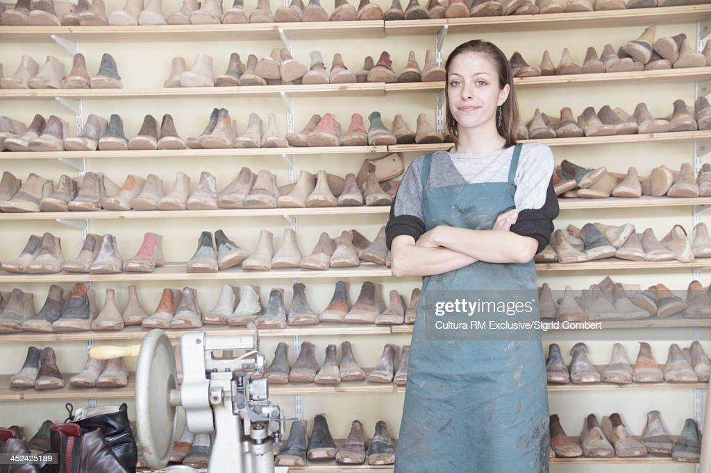 Female cobbler in workshop