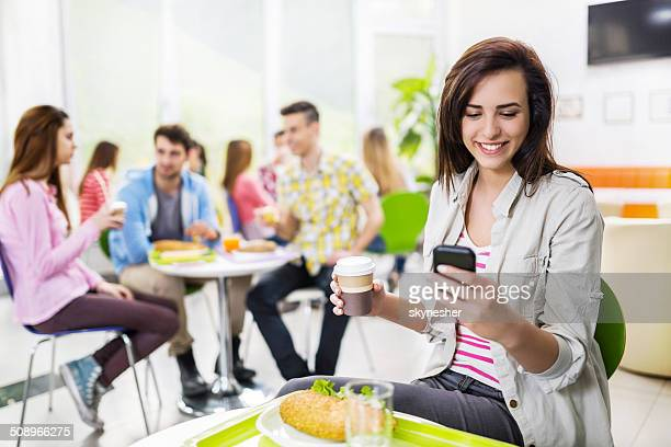 Female college student in cafeteria.