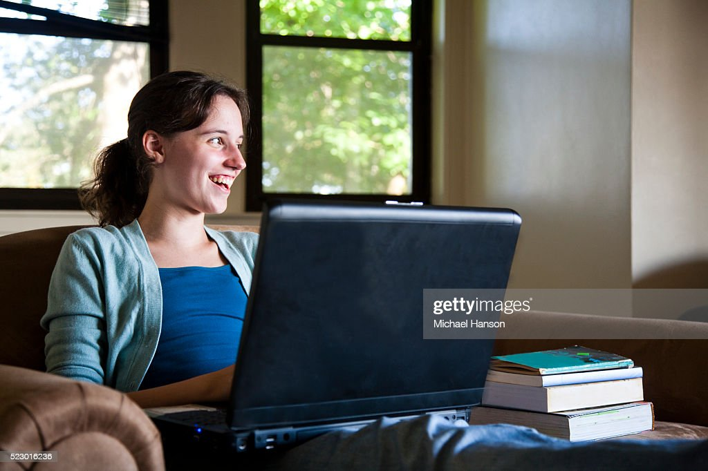 Female College Student In Her Dorm Room Working On Computer : Stock Photo Part 41