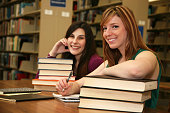 Female College Students in a Library with Lots of Books