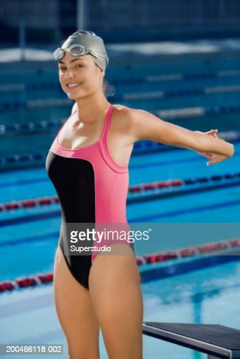 Female competition swimmer stretching, portrait