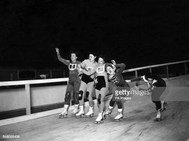 Female competitors struggle for the lead during final training for the America versus Europe roller speedway at Harringay London