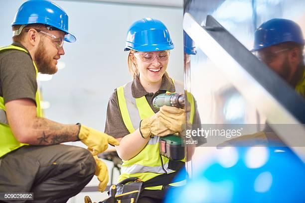 female construction apprentice and colleague