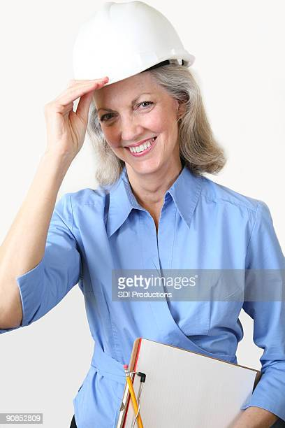 Female Construction Manager Tipping Her Hard Hat
