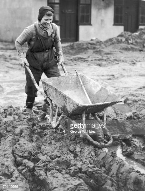 A female construction worker helps build a government camp in the north of England during World War II 10th November 1941 She and her colleagues are...