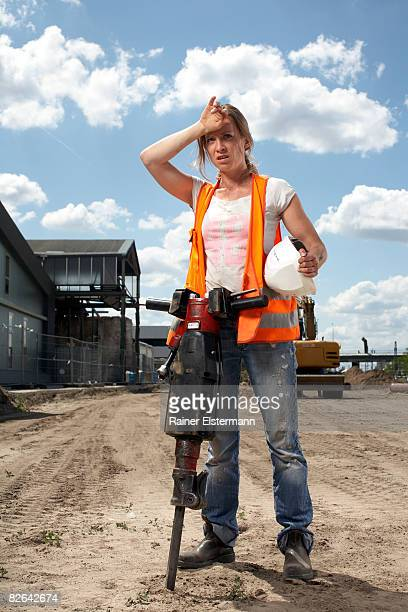 Female construction worker with machinery