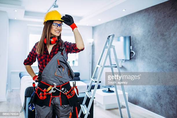 Female construction worker with tools