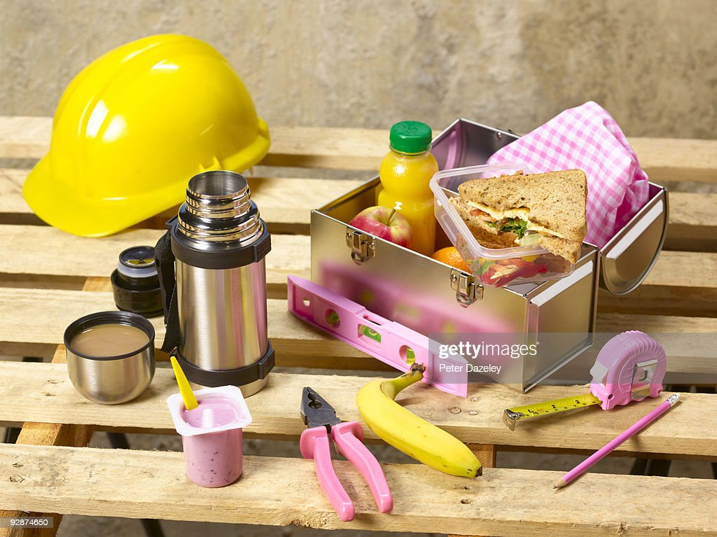 Female construction workers healthy lunch box. : Stock Photo