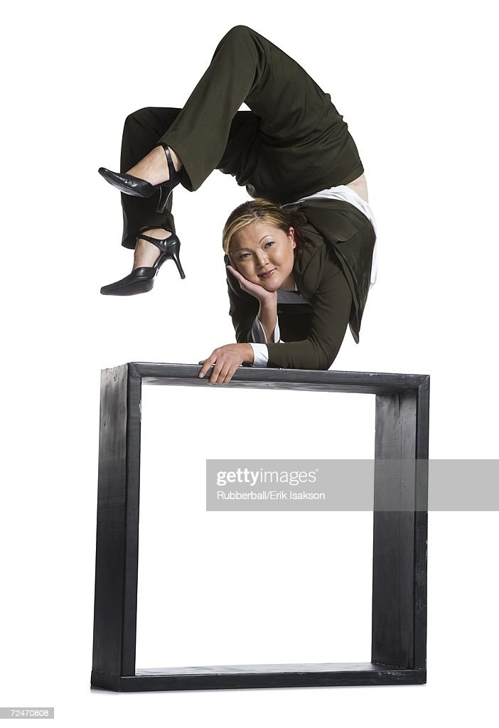 Female contortionist businesswoman outside the box : Stock Photo