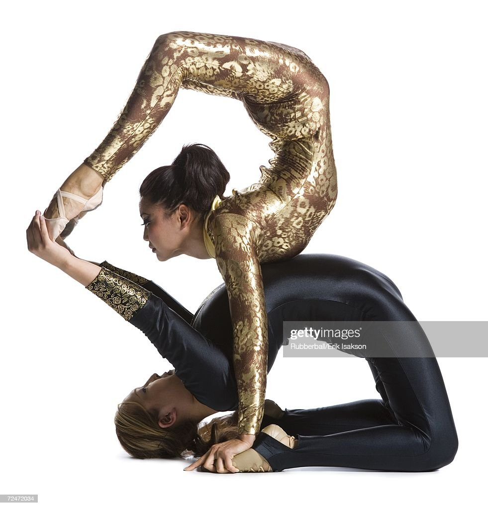 Female contortionist duo performing