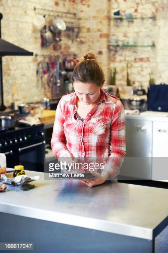 female cook on tablet : Stock Photo