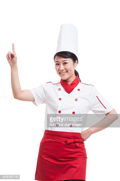 Female cook pointing up