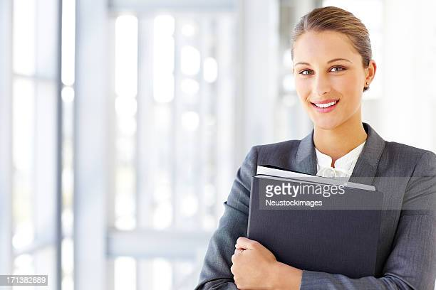Female Corporate Worker Holding An Office File