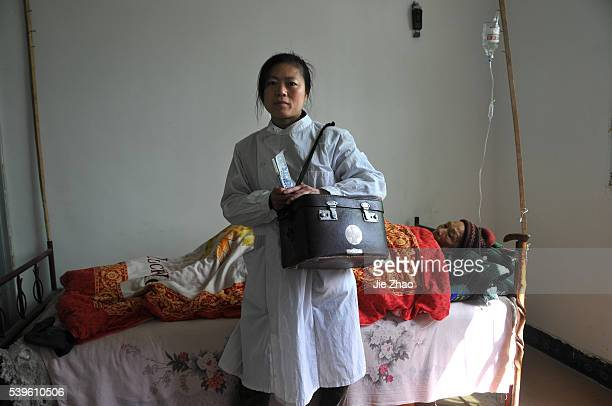 A female country doctor poses for photography at the clinic room in Yicheng Hubei province China Pictures taken on 23th April 2010 Xinyu Zhang