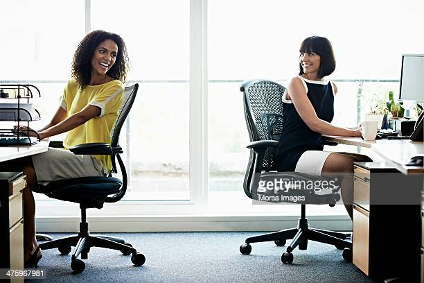 Female coworkers laughing