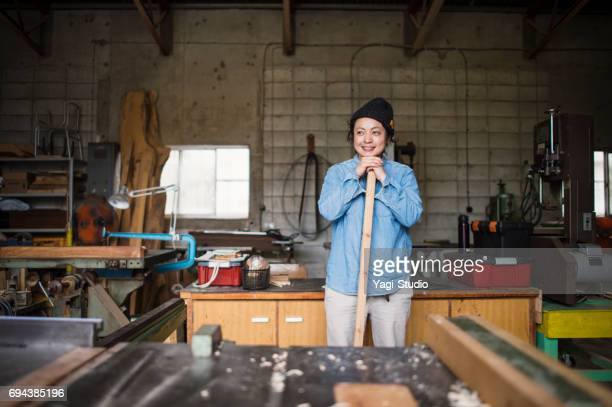 Female craftsperson working in woodworking studio