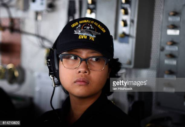 A female crew member looks on from the bridge of the USS Ronald Reagan on July 14 2017 in Townsville Australia USS Ronald Reagan is a 1092 foot...