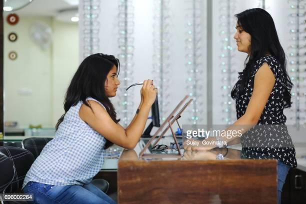 Female Customer Choosing Eyeglass