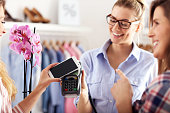 Female customer paying with credit card