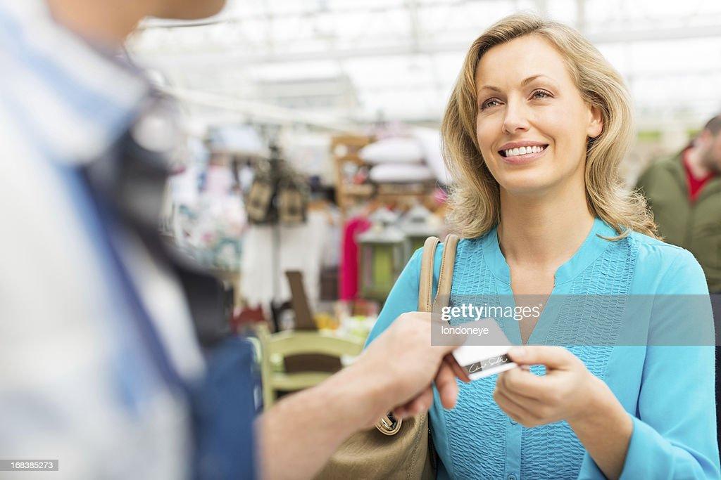 Female Customer Paying Through Credit card
