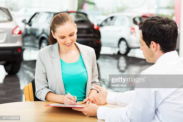 Female Customer Signing Agreement