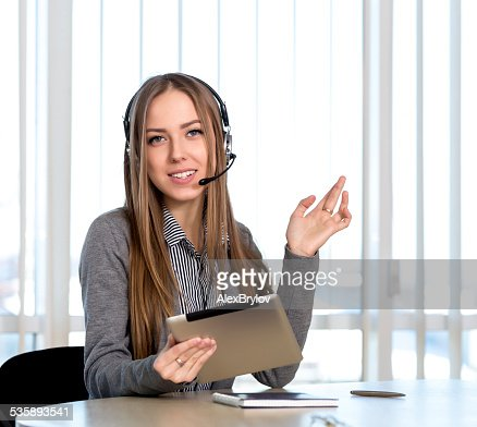 Female customer support officer looking to the camera : Stock Photo
